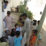 Children of flood victims receiving filtered water
