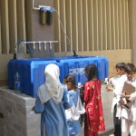 Students drinking filtered water at Qasim al Uloom School Orangi Karachi